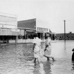 19 - Women Wading in flood water 1930s